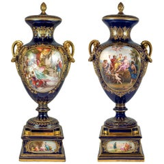 Pair of Royal Vienna Painted Porcelain Urn and Cover