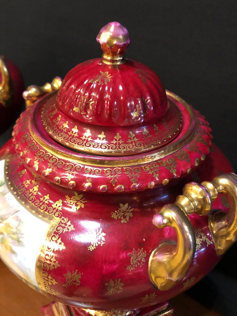 German Pair of Royal Vienna Red Lidded Vases with Renaissance Painted Motif For Sale