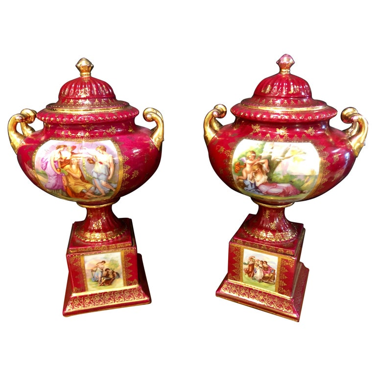 Pair of Royal Vienna Red Lidded Vases with Renaissance Painted Motif For Sale