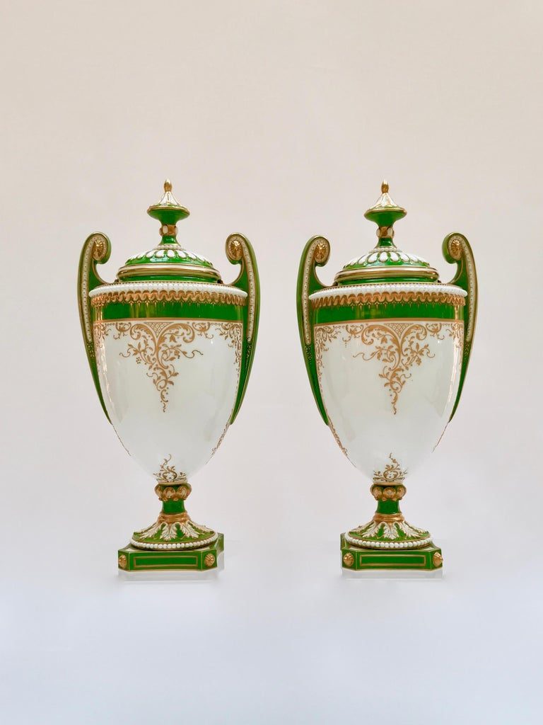 This is a pair of beautiful vases with cover made by Royal Worcester in 1907, painted and signed by the famous porcelain artist William Hawkins.  The original Worcester pottery was founded in the mid-18th century and belongs to the group of famous