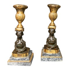 Pair of Russian Neoclassical Gilt and Patinated Bronze Sphinx Candlesticks