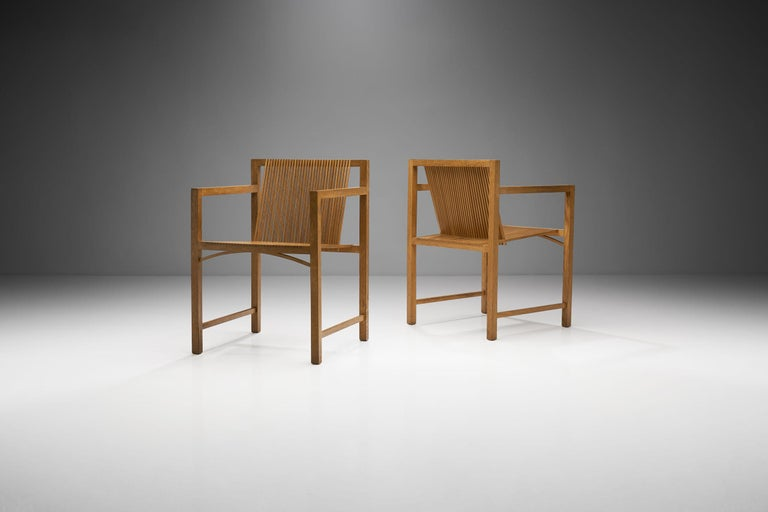 """Designed by Ruud-Jan Kokke, these slat chairs were produced by the Dutch manufactory Spectrum, in 1986 as part of their series called """"Kokke-Chairs"""".  This pair's frames are manually assembled and are made of oak, while the resilient slats are"""