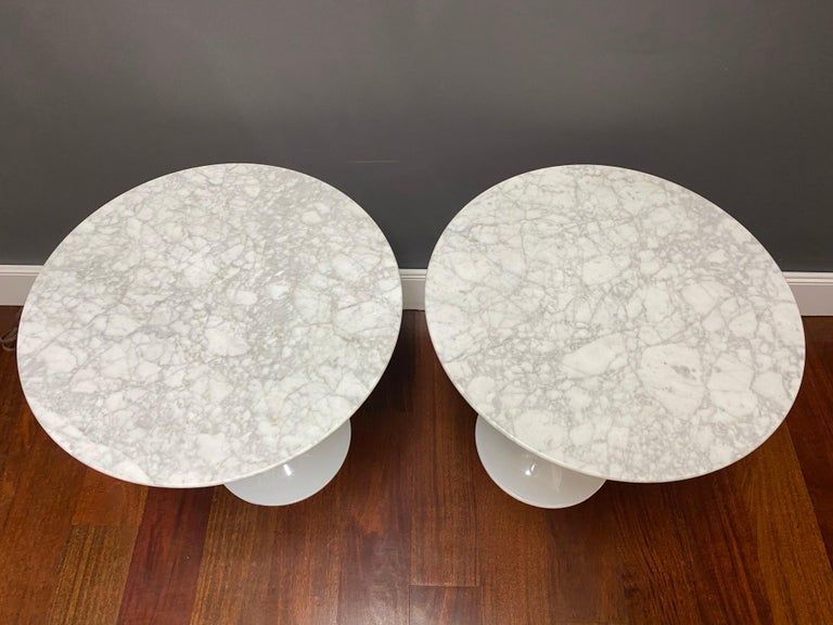 A pair of quality Saarinen style tulip side tables with marble tops.