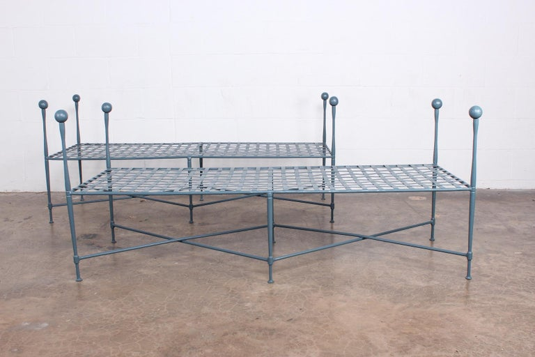 A pair of sculptural iron lattice top benches by Salterini. Newly powder coated.