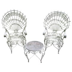 Pair of Salterini Style Wrought Iron Fan Back Peacock Patio Chairs and Table