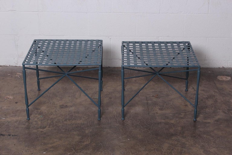A pair of sculptural iron lattice top tables by Salterini. Newly powder-coated.