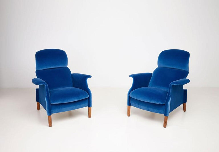 Pair of Sanluca armchairs dating back to the first Gavina SpA production, recently upholstered in cotton velvet. Each armchair is made of separate wooden curved pieces, connected to each other by screws. Sanluca is the first result of deep