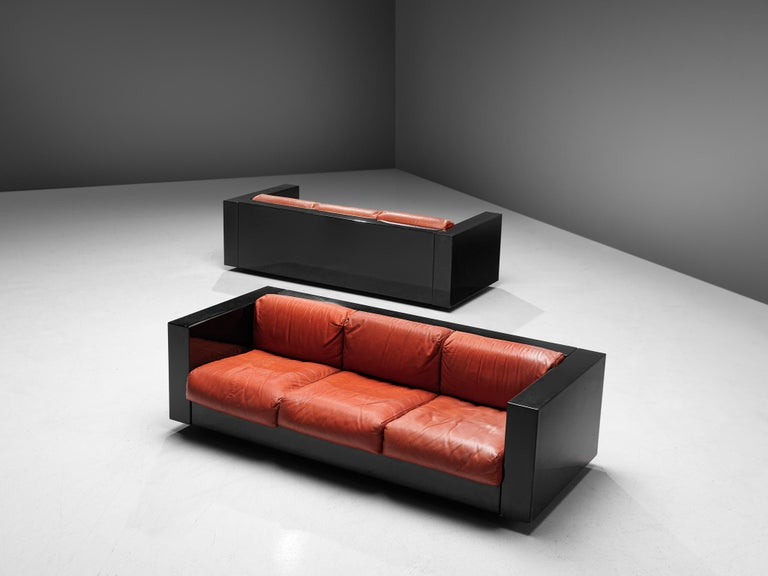 Massimo and Lella Vignelli for Poltronova, pair of 'Saratoga' three-seat sofas, polyester lacquer and red leather, Italy, 1964.  These three-seat sofas named 'Saratoga' are designed by Italian designer couple Lella & Massimo Vignelli. The Vignelli's