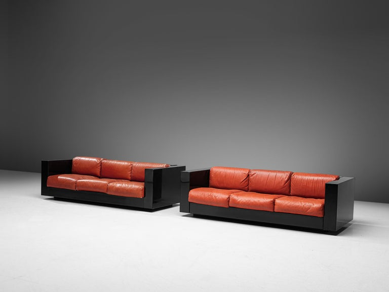 Italian Pair of 'Saratoga' Black Sofas with Red Leather by Vignelli For Sale