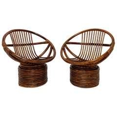 Pair of Saucer Form Swivel Lounge Rattan Chairs, circa 1960s