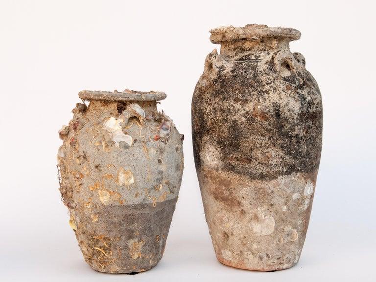 Pair of Sawankhalok Jars with Encrustations. Sawankhalok, Thailand, 15th century. These jars originate from the kilns of central Thailand centered around the area of Si Sachanalai dating to the Sukhothai period. Sawankhalok ceramics were widely