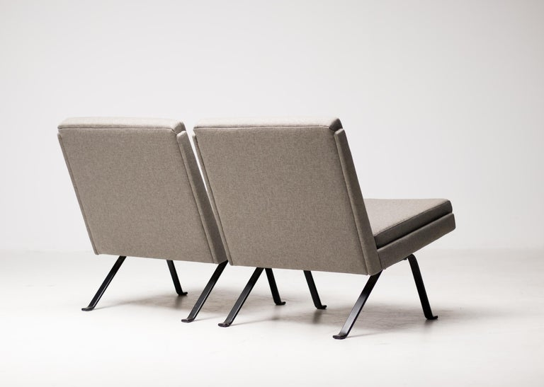Very comfortable pair of 2 lounge chairs, made in Denmark, circa 1960. Reupholstered in a beautiful grey fabric that accentuates the geometric shape of the chairs. Priced as a pair.