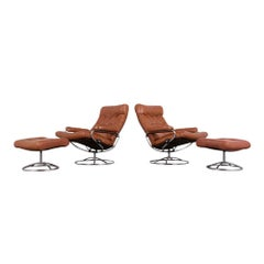 Pair of Scandinavian Leather Swivel Reclining Lounge Chairs