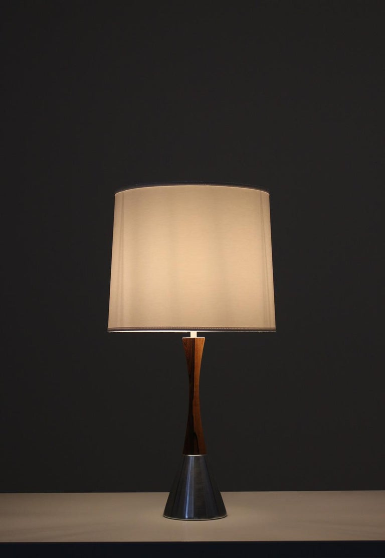 Set of two rare table lamps by Bergboms, Sweden, 1960s. The lamps are made of rosewood and brushed metal. The design is simple and elegant with the slim waist and the beautiful contrast between the wood and the metal. Condition: Very good vintage