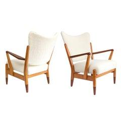 Pair of Scandinavian Modern Lounge Chairs with Faux Sheepskin, Teak Details