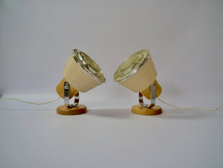 Pair of wall mount bedside lamps fabricated by Markslöjd in the 1970s. The beige fabric lampshade gives a soft and warm light.