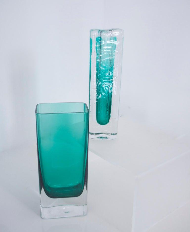 Pair of Scandinavian Modernist glass pillar vases by Nuutajarvi Notsjõ  Nuutajarvi Notsjo was established in 1793, in Urjala, Finland, by Jacob Wilhelm de Pont and Harald Furnhjelm, originally making window glass and bottles. The company changed