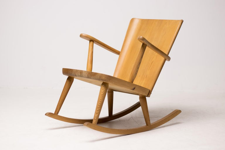 Rocking chairs, made in solid pine, designed by Göran Malmvall for Svensk Fur, Sweden.  Modernist design in traditional Swedish workmanship, similar to the designs of Axel Einar Hjorth.  Stamped marks. Priced individually.
