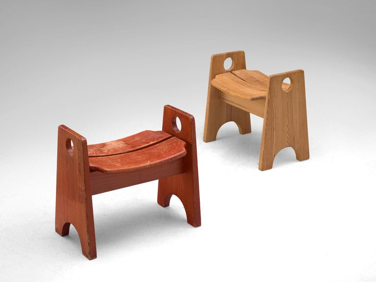 Pair of stools, solid oak, Scandinavia, 1950s.  This pair of stools are a nice additional to your interior and don't take much space.The natural colour of pinewood and red coated stool have each their unique patina. The design is simplistic,