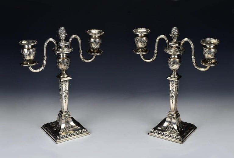 Pair of classical style two-part heavy cast silver candlesticks with weighted footings, marked Schwarz and Steiner, and bear the