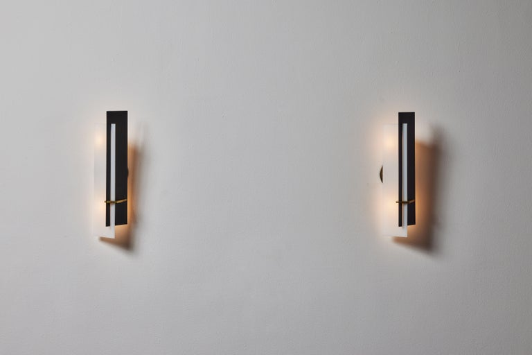 Pair of sconces by Angelo Brotto for Esperia. Designed and manufactured in Italy, circa 1960. Lacquered metal, brass, custom brass backplates and opal methacrylate. Original label. Wired for U.S. standards. We recommend two E14 40w maximum bulbs per