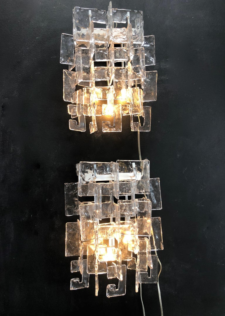 Pair of rare big C Cascade sconces by the designer Carlo Nason for the manufacture Mazzega. The great Murano glass quality, 30 amber and 44 white ice glass. Really important by the glass size and long for a pair of this style.