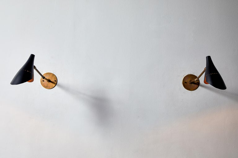 Mid-Century Modern Pair of Sconces by Lumen For Sale