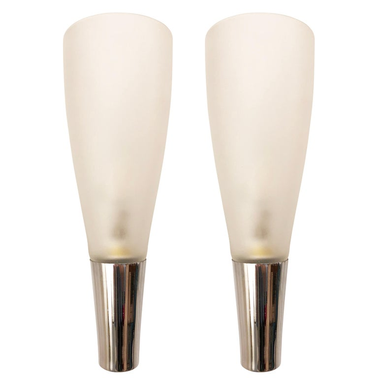 Classic pair of sconces designed by Pietro Chiesa for Fontana Arte in the late 1930s and attributed by some to Gio Ponti. They feature an iridescent frosted glass of superior quality on a nickel frame. Both Pietro Chiesa and Gio Ponti designed for