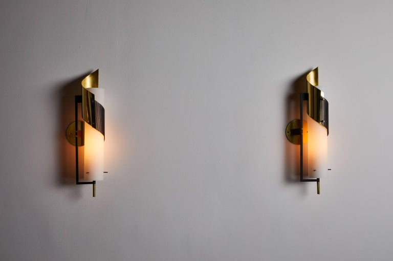 Pair of sconces by Stilnovo. Manufactured in Italy, circa 1960s. Brushed satin glass, enameled metal and brass. Rewire for US junction boxes. Custom brass backplates. Each sconces takes one E27 100w maximum bulb.