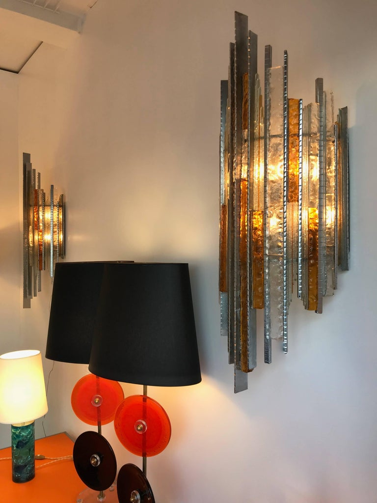 Very rare an monumental pair of sconces or wall lights by Biancardi and Jordan Arte at Verone Italy, they were the direct concurrent of Poliarte during the 1970s. Amber and clear hammered glass and cut-glass on silver wrought iron structure. Very