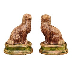 Pair of Scottish 1880s Brown Glazed Pottery Dog Sculptures Raised on Oval Bases