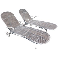 Pair of Sculptura Outdoor Iron Chaise Lounges by Russell Woodard