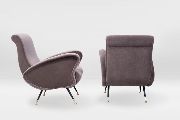 Midcentury Italian armchairs, 1950s, legs in black lacquered steel, brass feet, reupholstered in Kvadrat velvet (Harald).