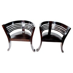 Pair of Sculptural Black Lacquer Arm Chairs
