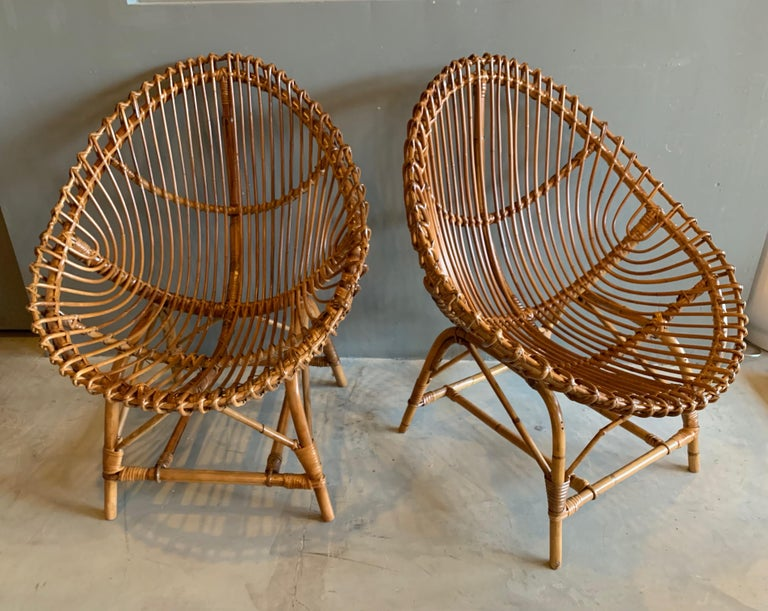 Elegant pair of rattan and bamboo chairs. Made in Italy. Very good vintage condition. Great scale.