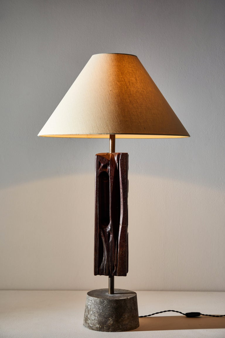 Unique pair of rare sculptures mounted as table Lamps by Yasuo Fuke in Italy, circa 1970s. Hand carved wood, brass, marble. Rewired for US standards with black french twist cord. Custom linens shades. Signed and numbered by the artist. We recommend
