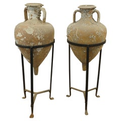 Pair of Sea Salvaged Roman Amphorae with 19th Century Wrought Iron Stands