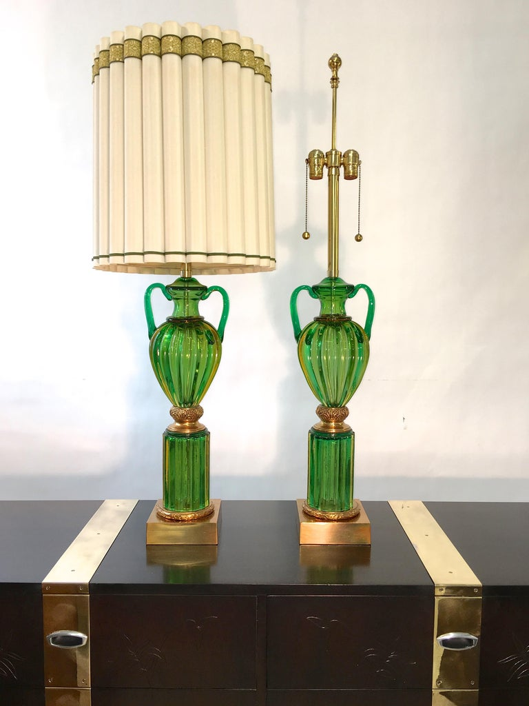 Monumental pair of table lamps as fresh as when they were first made in the 1960s by Marbro Lamp Co with imported emerald green Seguso Murano glass and polished brass fittings.  44 inches high to top of finials. 35 inches high to top of