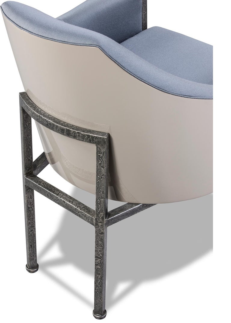 Iron frame in antique silver finish, supporting an upholstered seat, back and armrests, the back finished in a putty lacquer finish. Custom sizes and finishes available.
