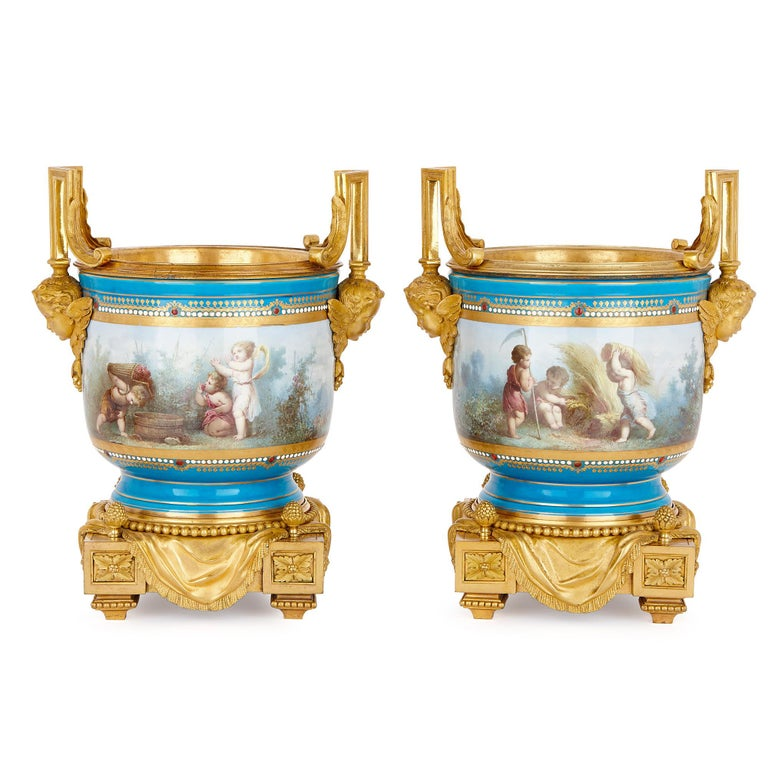 In their painted decoration, these vases demonstrate the technical excellence of Sèvres factory porcelain. While the porcelain vases alone would be impressive enough, the items have also been decorated with fine gilt bronze mounts, cast by Henri