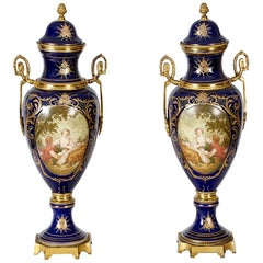 Pair of Sèvres Vases With Bronze Mounts and Handled Sides