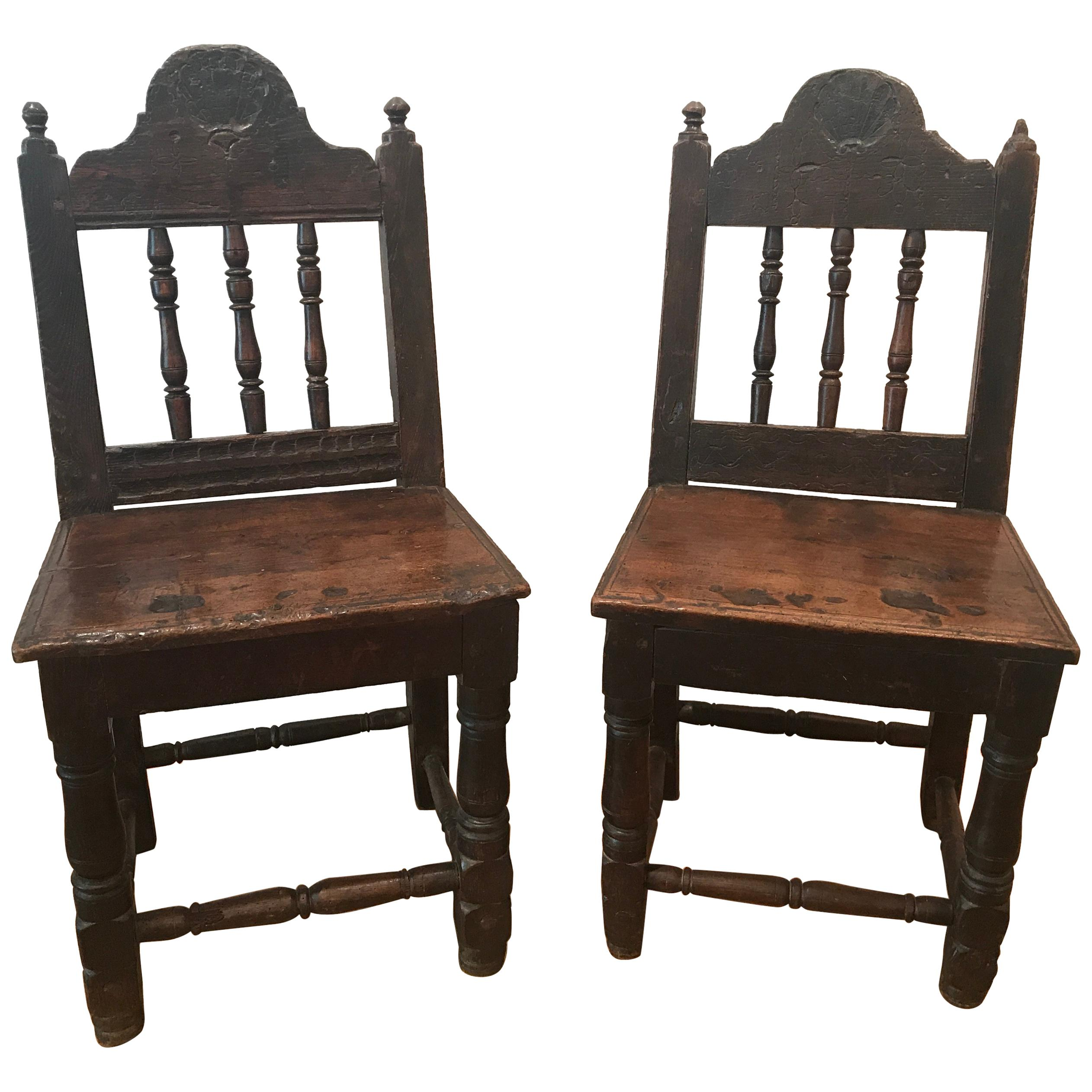 Pair of shell carved chairs for sale at stdibs