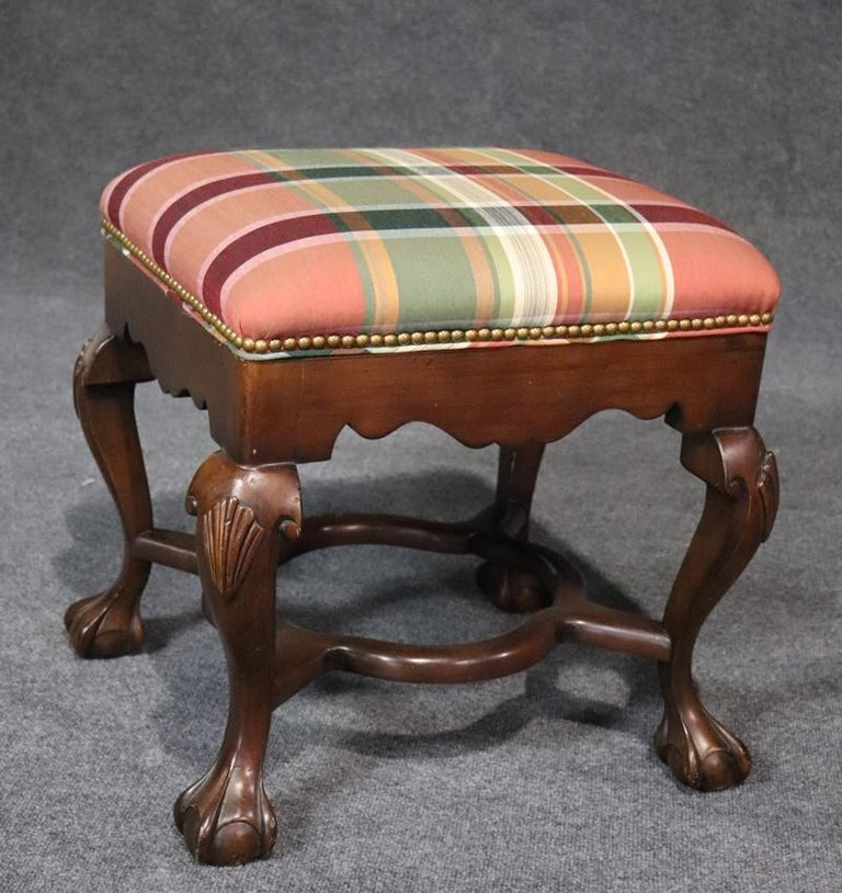 This is a gorgeous pair of Sherrill of North Carolina, Georgian style mahogany footsools with ball and claw feet and nailhead trim with fine and clean high quality upholstery. They are perfect in any room and are in superb condition.