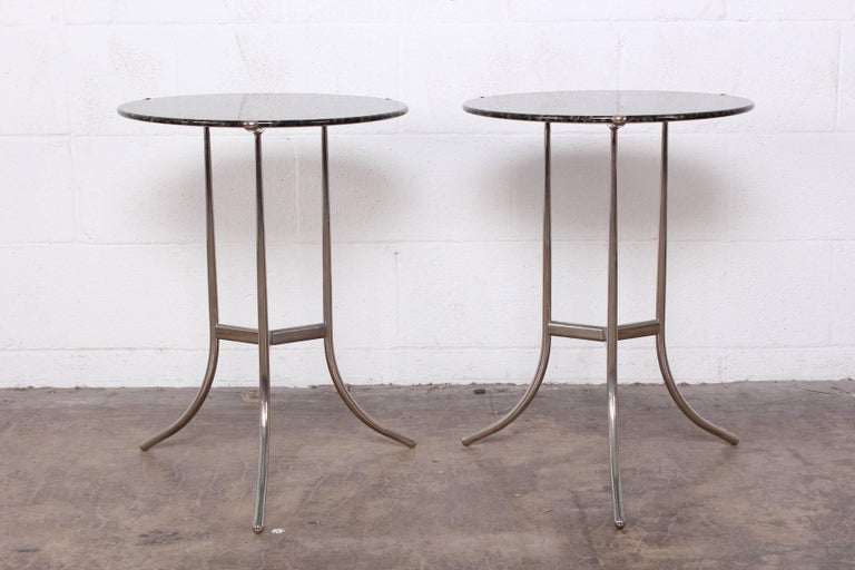 A pair of Cedric Hartman side tables with bevelled stone tops.