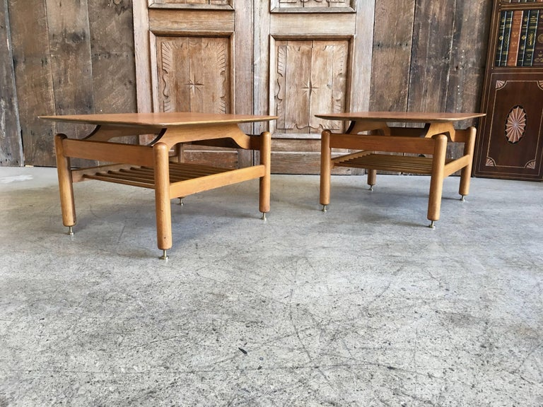 A very nice pair of walnut side tables designed by Greta Grossman for Glenn of California in the 1950s. Original finish.