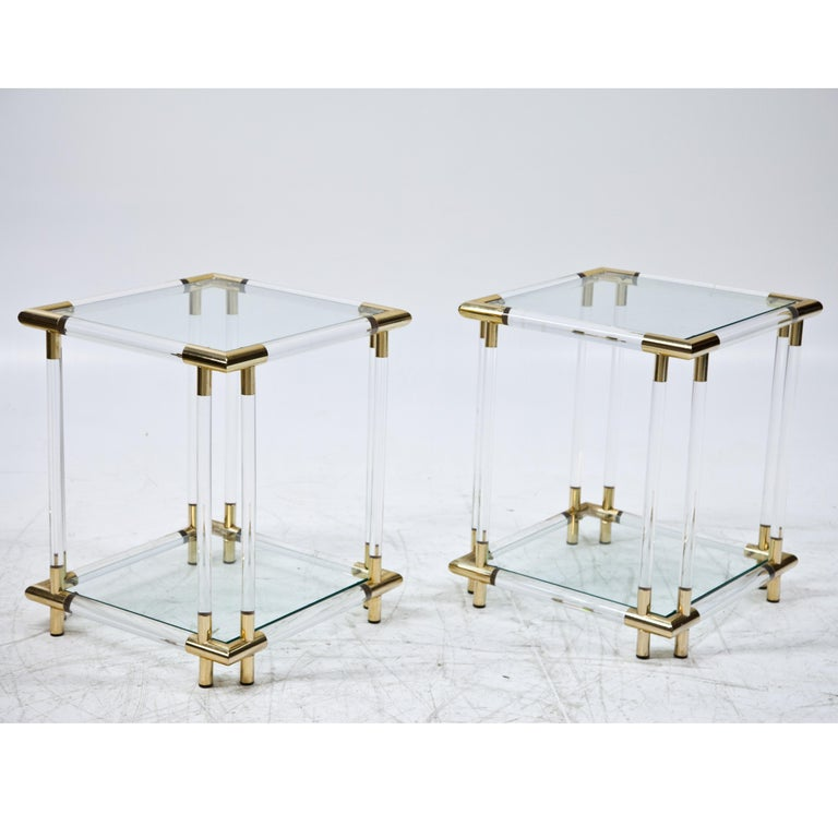 Pair of side tables Lucite and glass with brass accents.