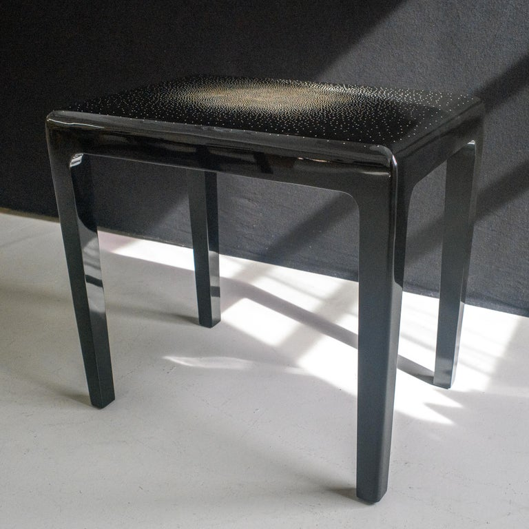 A pair of large side tables in black lacquer with a fine design in egghell.
