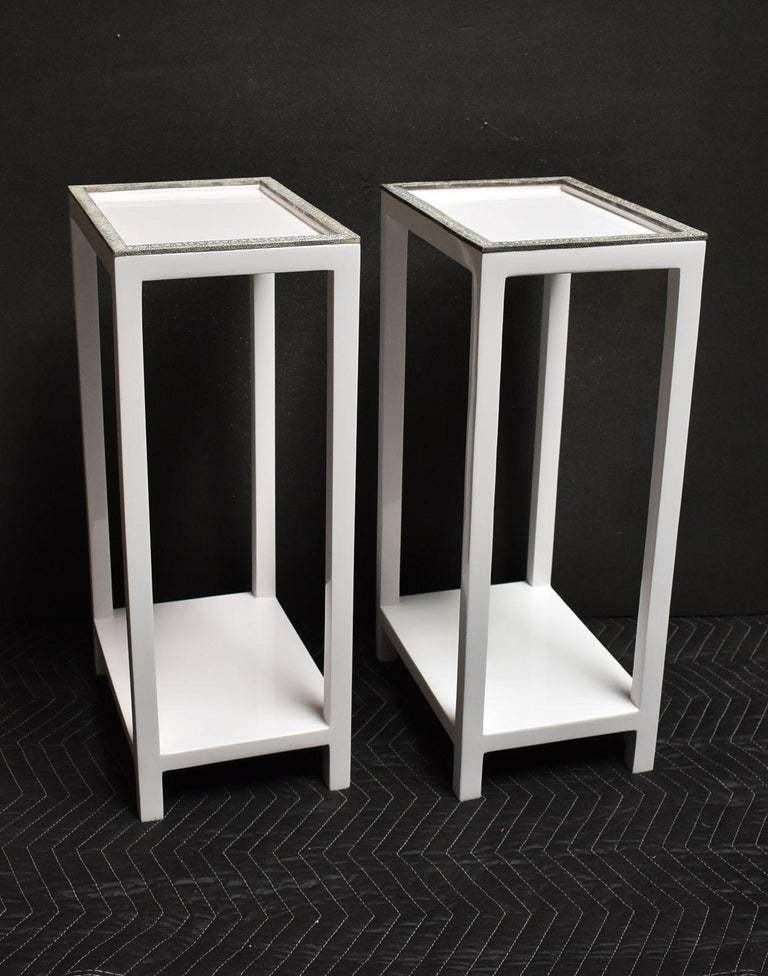 Pair of white resin two tiers side tables with grey and white shagreen trim.