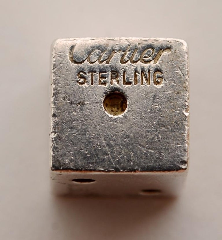 Pair of Signed Cartier Solid Sterling Silver Dice. The .925 sterling silver dice set features 2 die made in solid sterling silver, each signed
