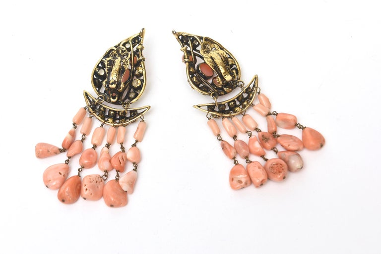 This stunning pair of signed vintage Iradj Moini Coral, Citrine and Rhinestone clip on dangle earrings are beyond fabulous. The brass is gilded to look old. There are 6 strands of angel coral on each earring. it is old world meets modern. They have
